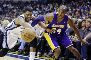 Photo - Memphis Grizzlies' Rudy Gay, left, and Los Angeles Lakers' Kobe Bryant (24) battle for a loose ball during first half of an NBA basketball game in Memphis, Tenn., Wednesday, Jan. 23, 2013. (AP Photo/Daniel Johnston)