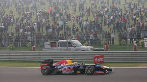 Photo -   Red Bull driver Sebastian Vettel of Germany steers his car during the Indian Formula One Grand Prix at the Buddh International Circuit in Noida, on the outskirts of New Delhi, India, Sunday, Oct. 28, 2012. (AP Photo/Manish Swarup)