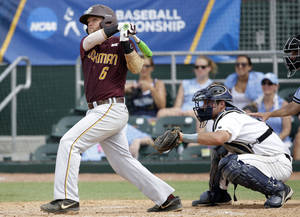 Photo - Bethune-Cookman's Matt Noble (6) follows through on a double to score two runs as Columbia catcher Mike Fischer, right, looks on in the seventh inning during an NCAA college baseball regional tournament in Coral Gables, Fla., Saturday, May 31, 2014. Bethune-Cookman defeated Columbia 6-5. (AP Photo/Lynne Sladky)