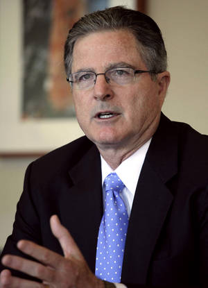 photo - In this Thursday, Nov. 29, 2012 photo, Chevron CEO John Watson talks during an interview, in New York. Watson, 55, a California native and Chevron lifer, joined the company in 1980 as a financial analyst. Before becoming CEO in 2010 he was vice chairman in charge of strategic planning, business development and mergers and acquisitions. He also ran the company's international exploration and production business, led the company's integration with Texaco and was CFO.  (AP Photo/Mark Lennihan)