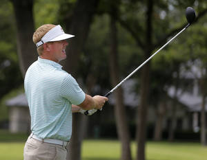 Photo - Former Oklahoma State, and current Dallas Cowboy quarterback, Brandon Weeden watches his tee shot during his Swing From The Heart Annual Golf Challenge at Oak Tree National in Edmond, Okla., Friday, June 20, 2014. Photo by Bryan Terry, The Oklahoman