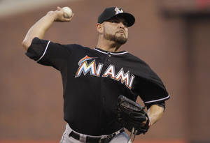 Photo -   Miami Marlins pitcher Ricky Nolasco (47) pitches against the San Francisco Giants during the third inning of a baseball game in San Francisco, Calif., Tuesday, May 1, 2012. (AP Photo/Jeff Chiu)