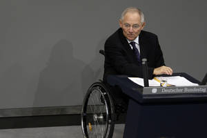 photo - German Finance Minister Wolfgang Schaeuble gestures during his speech as part of a meeting of the German federal parliament, Bundestag, in Berlin, Germany, Friday, Nov. 30, 2012. (AP Photo/Michael Sohn)