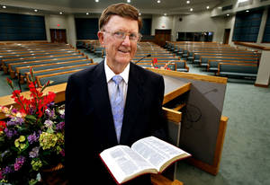 Photo - Lewis Hale, 87, stands in the sanctuary of , Southwest Church of Christ where he recently retired as longtime pulpit minister.  <strong>STEVE SISNEY - THE OKLAHOMAN</strong>