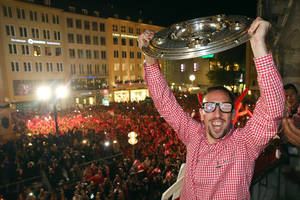 Photo - In this picture taken Saturday May 10, 2014,  Bayern Munich soccer player Franck Ribery , with funny glasses, raises the trophy  on the balcony of the city hall  during celebrations for Bayern's  Champions' title   in Munich , Germany.   (AP Photo/Alexander Hassenstein,Pool)