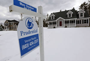 Photo - In this Tuesday, March 5, 2013, photo, a home is for sale in Auburn, N.H.  Standard & Poor's/Case-Shiller reports on home prices in February on Tuesday, April 30, 2013. (AP Photo/Charles Krupa)