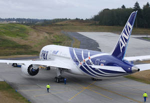 Photo - The first Boeing Co. 787 plane delivered to a commercial customer taxis for take off to Japan, Tuesday, Sept. 27, 2011, in Everett, Wash. The plane will be operated by Japan's All Nippon Airways. (AP Photo/Ted S. Warren) ORG XMIT: WATW111