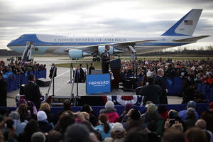 Photo -   With Air Force One in the background, President Barack Obama speaks to supporters during a campaign event on the tarmac at Austin Straubel International Airport in Green Bay, Wis.,Thursday, Nov. 1, 2012. Obama resumed his presidential campaign with travel to key background states of Wisconsin, Colorado, Nevada and Ohio today. (AP Photo/Pablo Martinez Monsivais)