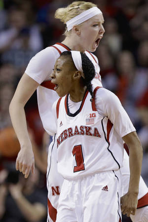 Photo - Nebraska's Tear'a Laudermill (1) and Emily Cady celebrate after Laudermill hit a 3-pointer in the first half of an NCAA college basketball game against Penn State in Lincoln, Neb., Monday, Feb. 24, 2014. (AP Photo/Nati Harnik)