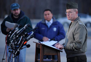 Photo - Col. David W. Maxwell holds a press conference at the Marine Corps Museum in Quantico, Va., on Friday, March 22, 2013 regarding a murder/suicide that occurred on Thursday night that resulted in the deaths of three Marines. A Marine killed a male and female colleague in a shooting at a base in northern Virginia before killing himself, officials said early Friday. (AP Photo/The Free Lance-Star, Peter Cihelka)