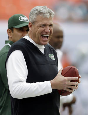 Photo - FILE - In this Dec. 29, 2013, file photo, New York Jets head coach Rex Ryan has a laugh on the sideline before an NFL football game against the Miami Dolphins in Miami Gardens, Fla. The Jets have signed Ryan to a contract extension, removing the lame duck label and keeping him with the franchise for at least the next two years.(AP Photo/Alan Diaz, File)