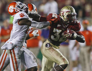 Photo -   Florida State running back James Wilder Jr. (32) stiff-arms Clemson cornerback Bashaud Breeland (17) on a 35-yard run during the fourth quarter of an NCAA college football game on Saturday, Sept. 22, 2012, in Tallahassee, Fla. (AP Photo/Phil Sears)