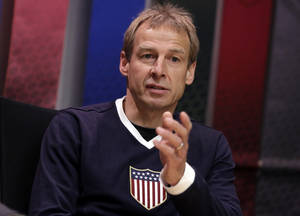 Photo - FILE - In this April 5, 2013, file photo, U.S. national soccer team coach Jurgen Klinsmann answers questions during an interview in New York. Klinsmann could face his native Germany at the World Cup if the teams are put into the same group at the World Cup draw on Friday, Dec. 6, 2013, in Brazil. (AP Photo/Richard Drew, File)