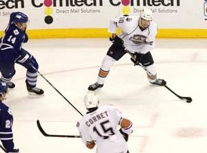 Photo - OKC Barons' Teemu Hartikainen passes the puck to teamate Phillippe Cornet as they play the Toronto Marlies during Field Trip Day at the Cox Convention Center in Oklahoma City, OK, Tuesday, Nov. 8, 2011. By Paul Hellstern, The Oklahoman <strong>PAUL HELLSTERN</strong>