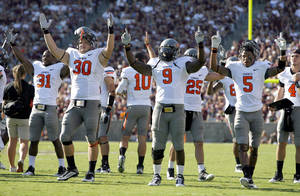 Photo - Oklahoma State celebrates a touchdown in the second half during a college football game between the Oklahoma State Cowboys (OSU) and the Texas A&M Aggies at Kyle Field in College Station, Texas, Saturday, Sept. 24, 2011. Photo by Sarah Phipps, The Oklahoman