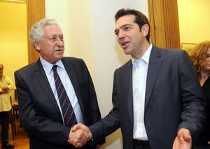 Photo -   Greek leader of Coalition of the Radical Left party (SYRIZA), Alexis Tsipras, right, and leader of the Democratic Left party, Fotis Kouvelis, smile before their meeting at the Greek Parliament in Athens, Tuesday, May 8, 2012. Greece's commitment to austerity is no longer valid because voters have rejected those deals, Tsipras declared Tuesday as he tried to form a new coalition government. (AP Photo/Evi Fylaktou)