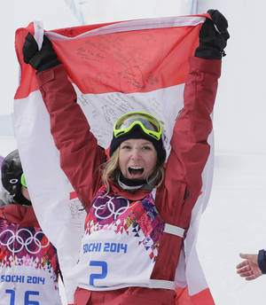 Photo - Canada's Dara Howell celebrates after taking the gold medal in the women's freestyle skiing slopestyle final at the Rosa Khutor Extreme Park at the 2014 Winter Olympics, Tuesday, Feb. 11, 2014, in Krasnaya Polyana, Russia. (AP Photo/Andy Wong)