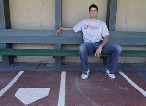 Photo - In this photo taken Monday May 20, 2013, Stanford pitcher Mark Appel poses in the dugout of the Sunken Diamond in Stanford, Calif. As Appel sat in the Stanford dugout and glanced out at the field this week, the star pitcher reminded himself just how much it meant to return for his final college season. Unpopular choice for some, the right one for a projected high first-round draft pick once again a year after he turned down the Pittsburgh Pirates as the eighth overall choice to go back to school. (AP Photo/Eric Risberg)