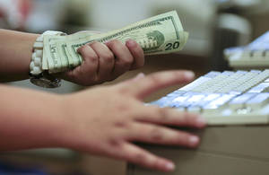 Photo -  A cashier rings up a sale at a Sears store in Las Vegas.  AP File Photo  <strong>Julie Jacobson</strong>