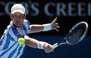 Photo - Tomas Berdych of the Czech Republic makes a backhand return to David Ferrer of Spain during their quarterfinal at the Australian Open tennis championship in Melbourne, Australia, Tuesday, Jan. 21, 2014.(AP Photo/Aaron Favila)
