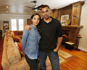 Photo - Bertille and Thabo Sefolosha at their home in Oklahoma City , Tuesday April 2, 2013. Photo By Steve Gooch, The Oklahoman ORG XMIT: OKC1303121532440650