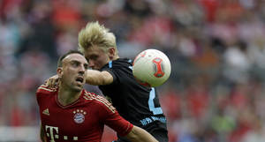 Photo -   Bayern's Franck Ribery of France, left, and Hoffenheim's Andreas Beck challenge for the ball during the German first division Bundesliga soccer match between FC Bayern Munich and TSG 1899 Hoffenheim in Munich, southern Germany, Saturday, Oct. 6, 2012. (AP Photo/Matthias Schrader)