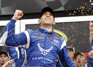 Photo - Aric Almirola celebrates in Victory Lane after winning the NASCAR Sprint Cup Series auto race at Daytona International Speedway in Daytona Beach, Fla., Sunday, July 6, 2014. (AP Photo/Terry Renna)