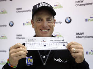 Photo - Jim Furyk holds up his scorecard after a news conference in the second round of the BMW Championship golf tournament at Conway Farms Golf Club in Lake Forest, Ill., Friday, Sept. 13, 2013. Furyk posted a single round 59, tying a PGA Tour record. (AP Photo/Charles Rex Arbogast)