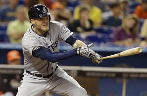 Photo - Seattle Mariners' Corey Hart hits a single during the fourth inning of an interleague baseball game against the Miami Marlins, Friday, April 18, 2014, in Miami. (AP Photo/Lynne Sladky)