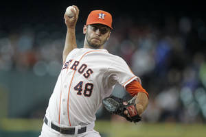 Photo - Houston Astros pitcher Jarred Cosart throws during the first inning of a baseball game against the Miami Marlins, Saturday, July 26, 2014, in Houston. (AP Photo/Patric Schneider)