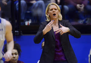 Photo - Minnesota head coach, Pam Borton leads her team as they play South Dakota State in Thursday's 3rd round WNIT basketball game at Frost Arena in Brookings, S.D. March 27, 2014. SDSU beat Minnesota 70-62.(AP Photo/Argus Leader, Elisha Page) NO SALES