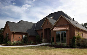 Photo - The St. Jude Dream Home is shown in the Chitwood Farms addition in Edmond.  Photo by SARAH PHIPPS,  the oklahoman