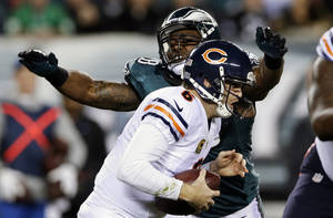 Photo - Chicago Bears' Jay Cutler is sacked by Philadelphia Eagles' Trent Cole during the first half of an NFL football game, Sunday, Dec. 22, 2013, in Philadelphia. (AP Photo/Michael Perez)
