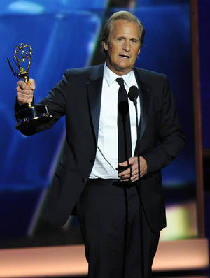 "Photo - Jeff Daniels accepts the award for outstanding lead actor in a drama series for his role on ""The Newsroom"" at the 65th Primetime Emmy Awards at Nokia Theatre on Sunday Sept. 22, 2013, in Los Angeles.  (Photo by Chris Pizzello/Invision/AP)"