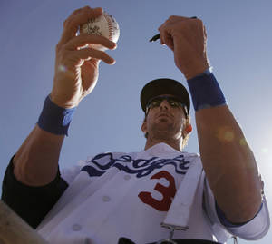 Photo - Los Angeles Dodgers' Jay Gibbons signs autographs before the Dodgers' spring training baseball game against the Colorado Rockies on Thursday, March 24, 2011, in Glendale, Ariz. (AP Photo/Nam Y. Huh) ORG XMIT: AZNH101