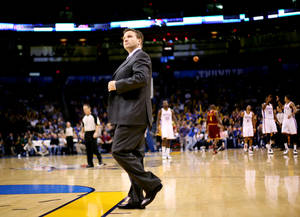 Photo - Oklahoma City Head Coach Scott Brooks walks onto the court during a timeout during the first half of the NBA basketball game against Cleveland at the OKC Arena in Oklahoma City on Sunday, Dec. 12, 2010. Photo by John Clanton, The Oklahoman