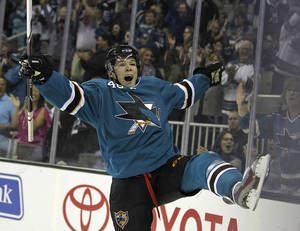 Photo - San Jose Sharks center Tomas Hertl celebrates after scoring a goal against Phoenix Coyotes during the first period an NHL hockey game in San Jose, Calif., Saturday, Oct. 5, 2013. (AP Photo/Tony Avelar)