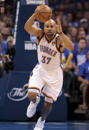 photo - FILE - This June 12, 2012 file photo shows Oklahoma City Thunder point guard Derek Fisher (37) breaking down court against the Miami Heat during the first half at Game 1 of the NBA finals basketball series, in Oklahoma City. What a year it's been for Fisher: serving as president of players' union during the lockout, traded from the Lakers and now making another NBA Finals run with the Thunder. AP PHOTO