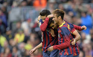 Photo - FC Barcelona's Cesc Fabregas, center, reacts after scoring from a penalty with his teammates Marc Bartra, left, and Neymar during a Spanish La Liga soccer match at the Camp Nou stadium in Barcelona, Spain, Saturday, Nov. 23, 2013. (AP Photo/Manu Fernandez)