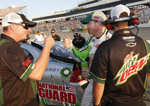 Photo -   Dale Earnhardt Jr., center, celebrates after qualifying for the NASCAR Sprint Cup Series auto race at Richmond International Raceway in Richmond, Va., Friday, Sept. 7, 2012. Earnhardt Jr. won the pole for Saturday night's race when he turned a lap at 127.023 mph. (AP Photo/Steve Helber)