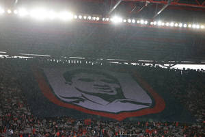 Photo - A banner with a picture of soccer legend Eusebio is unfurled on the stands during the Portuguese league soccer match between Benfica and Porto Sunday, Jan. 12 2014, at Benfica's Luz stadium in Lisbon. Portugal's and Benfica former player Eusebio died Jan. 5. (AP Photo/Armando Franca)