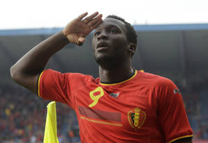 Photo - Belgium's Romelu Lukaku salutes after he scored against Luxembourg, during a friendly soccer match at the Cristal Arena stadium in Genk, eastern Belgium, Tuesday, May 26, 2014. Belgium will play against South Korea, Russia and Algeria in Group H of the World Cup 2014 in Brazil. (AP Photo/Yves Logghe)