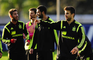 Photo - Spain's Gerard Pique gestures during a training session at the Atletico Paranaense training center in Curitiba, Brazil, Sunday, June 15, 2014. Spain will play in group B of the Brazil 2014 World Cup. (AP Photo/Manu Fernandez)