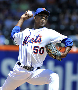 Photo - New York Mets starter Rafael Montero (50) pitches against the Arizona Diamondbacks in the first inning in game one of a doubleheader baseball game at Citi Field on Sunday, May 25, 2014, in New York. (AP Photo/Kathy Kmonicek)