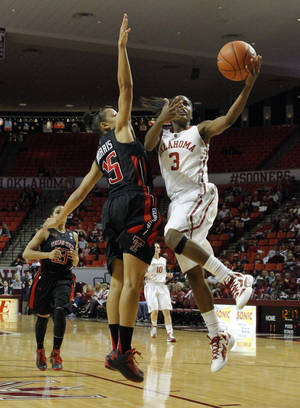 photo - Oklahoma Sooner's Aaryn Ellenberg (3) drives to the basket guarded by Tech's Casey Morris (15) as the University of Oklahoma Sooners (OU) play the Texas Tech Lady Red Raiders in NCAA, women's college basketball at The Lloyd Noble Center on Saturday, Jan. 12, 2013 in Norman, Okla. Photo by Steve Sisney, The Oklahoman