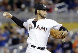 Photo - Miami Marlins' Henderson Alvarez delivers a pitch during the ninth inning of a baseball game against the New York Mets, Tuesday, May 6, 2014, in Miami. Alvarez pitched a six-hitter for his second shutout this season. Alvarez now has four career shutouts, including a no-hitter against Detroit on the final day of last season. (AP Photo/Wilfredo Lee)