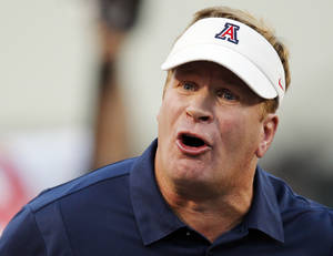 photo - REACTION: Arizona head coach Mike Stoops reacts in the first half during a college football game between the Oklahoma State University Cowboys (OSU) and the University of Arizona Wildcats at Boone Pickens Stadium in Stillwater, Okla., Thursday, Sept. 8, 2011. Stoops was fired Monday night halfway through his eighth season at Arizona. Photo by Nate Billings, The Oklahoman  