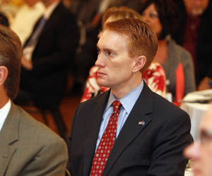 Photo - U.S. Rep. James Lankford, R-Oklahoma City, listens to guest speaker Wes Lane during the Mayor's Prayer Breakfast in Edmond on Tuesday. Photo by Paul Hellstern, The Oklahoman <strong>PAUL HELLSTERN - Oklahoman</strong>
