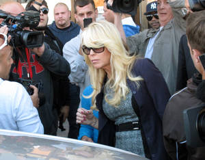 Photo - FILE - Dina Lohan leaves court in Hempstead, N.Y. in this Sept. 24, 2013 file photo after pleading not guilty to drunken driving charges. Lohan won't go to jail for speeding and driving drunk on a Long Island highway. A judge Tuesday, June 3, 2014, ordered her to pay over $3,000 in fines and fees. She'll also perform 100 hours of community service and participate in a drunken driving program. The 51-year-old's driver's license remains suspended. Her sentence includes a requirement that she install an alcohol-detecting ignition lock on her vehicle. Lohan pleaded guilty in April to aggravated driving while intoxicated and speeding on the Northern State Parkway in Nassau County. (AP Photo/Frank Eltman, File)