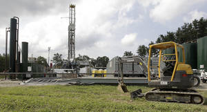 Photo - FILE - An Aug. 13, 2013 file photo shows a gas drilling rig at the Detweiler well in Salesville, Ohio. On Wednesday, Jan. 8, 2014, Ohio lawmakers will hear from backers of a proposal to hike taxes on horizontally drilled shale wells in Ohio. The measure is supported by Ohio's oil and gas industry, including owners of the Detweiler site, as a compromise to an earlier plan pushed by Gov. John Kasich. (AP Photo/Jay LaPrete, File)